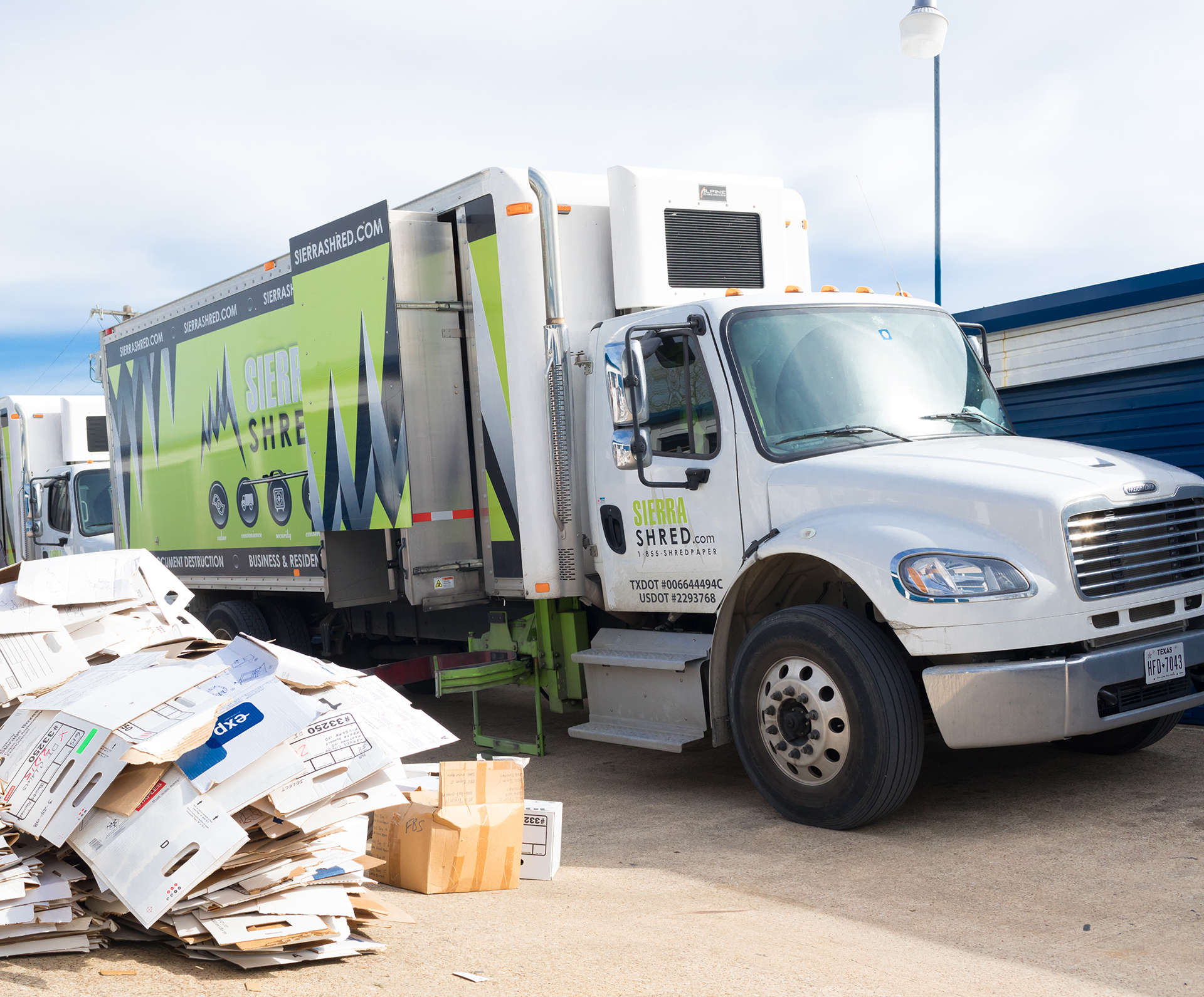 Sierra Shred trucks with papers